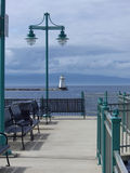 Fishing Pier. And north light on lake champlain Royalty Free Stock Images