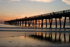 Fishing Pier. A Big Long Fishing Pier at Sunrise Royalty Free Stock Images
