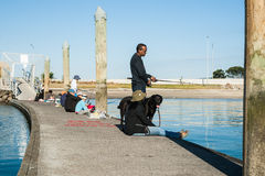 Fishing from pier. Royalty Free Stock Photography