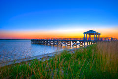 Fishing Pier. Sillhoutte Against a Colorful Dawn Sky Stock Image