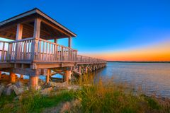 Fishing Pier. Against a Colorful Dawn Sky Stock Photography