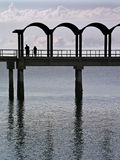 Fishing on the pier. People fishing from a pier Royalty Free Stock Image