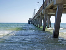 Fishing Pier in Alabama\'s Gulf State Park. This state pier is a favorite place for young and old to gather, fish, and tell fish stories to everyone who will Royalty Free Stock Image