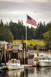 Fishing Pier and American Flag Stock Photos