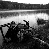 Fishing pier. Artistic look in black and white. Stock Photos