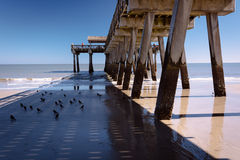 The fishing pier and Atlantic Ocean at Tybee Island, Georgia. Stock Image