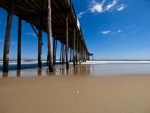 Fishing pier on the beach Royalty Free Stock Image