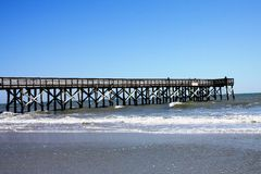 fishing pier on beach Stock Image
