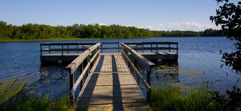Fishing Pier in Blue Lake Stock Image