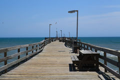 Fishing Pier Boardwalk Outer Banks North Carolina. Stretching 600 feet into the Atlantic Ocean, this renovated fishing pier offers fishing or a boardwalk for Royalty Free Stock Photography
