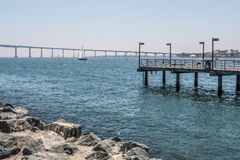 Fishing Pier with Coronado Bridge in San Diego. Fishing pier at Embarcadero Park South in San Diego, California, with the Coronado Bridge in the background royalty free stock photography