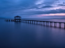 Fishing pier and dock at at dusk. An empty fishing pier at dusk, located on the calm waters of the Albermarle Sound at the Outer Banks of North Carolina Stock Photos
