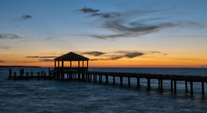 Fishing pier and dock at sunset Stock Photography
