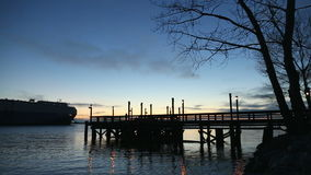 Fishing Pier Dusk and Car Freighter, Fraser River Royalty Free Stock Photo