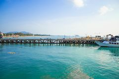 The fishing pier and  Ferry boat crossing . On the island. Stock Photos