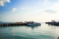 The fishing pier and  Ferry boat crossing . On the island. Royalty Free Stock Images