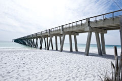 Fishing Pier in Florida in the Gulf of Mexico. Image of a fishing pier in Navarre, Florida.  The pier appears to disappear in the horizon.  The pier extends over Royalty Free Stock Photos