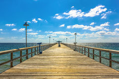 Fishing Pier Florida. Spectacular perspective view of the famous Anglins Fishing Pier in a sunny day with blue sky, Lauderdale by the Sea, 30 miles from Miami stock photos