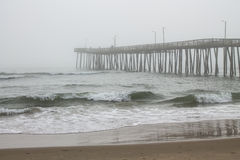 Fishing Pier with Fog Stock Photos