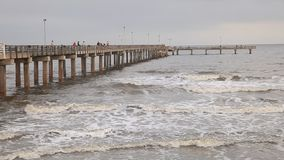 Fishing pier at the Gulf of Mexico coast stock footage