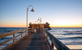 Fishing Pier. Located in the Oceanview area of Norfolk Virginia on the Chesapeake Bay at sunrise Royalty Free Stock Photos