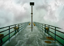 Fishing Pier during a storm on the lake. Stock Photos
