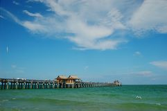 Fishing pier at Naples Beach, Florida. Fishing pier at municipal beach, Naples, Florida, Gulf of Mexico Royalty Free Stock Photo