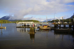 Fishing pier near Tofino Vancouver island. After a storm Stock Photos