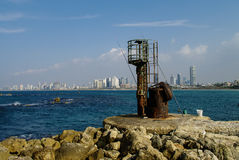 Fishing from pier in old Jaffa port. Panaramic view ti Tel Aviv. Israil Stock Images