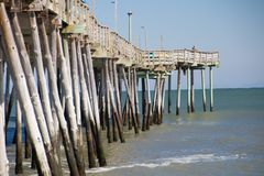 Fishing Pier on the Outer Banks of North Carolina. Fishing Pier in the Outer Banks of North Carolina overlooking the Atlantic Ocean royalty free stock photos
