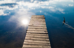 Fishing pier. Picture of wooden fishing pier and blue water Stock Photo