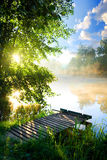 Fishing pier on river Royalty Free Stock Image