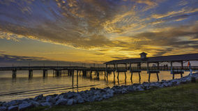 Fishing pier on St. Simons Island, GA, at sunset on a winter evening. Royalty Free Stock Photo
