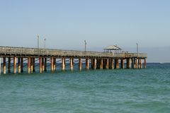 Fishing Pier on Sunny Isles Beach. The fishing pier at Sunny Isles Beach in Florida extends quite a ways into the ocean Royalty Free Stock Images