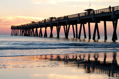 Fishing Pier. Sunrise at a fishing pier on the ocean Royalty Free Stock Photos