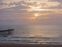 Fishing Pier at Sunrise at Virginia Beach, Virginia, USA.  Royalty Free Stock Photo