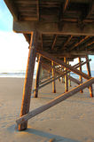 Fishing Pier - Sunset Beach NC. The fishing pier at sunset beach leads out from a dune area stock photography