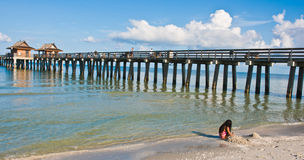 Fishing pier in tropical water Stock Images