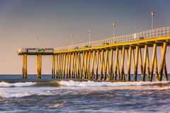 Fishing pier and waves on the Atlantic Ocean at sunrise in Ventn. Or City, New Jersey Stock Photos