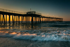 Fishing pier and waves on the Atlantic Ocean at sunrise in Ventn Stock Photo
