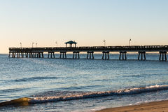 Dock pilings at sunrise at buckroe beach stock photo for Buckroe beach fishing pier