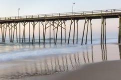 Fishing Pier at Kure Beach, North Carolina. Fishing pier and waves at Kure Beach, North Carolina Stock Image