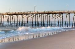 Fishing pier at Kure Beach, North Carolina. Fishing pier and waves at Kure Beach, North Carolina Royalty Free Stock Photography