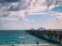 Fishing Pier West Palm Beach Florida. Horizon shot of a fishing pier in West Palm Beach area of Florida stock photography
