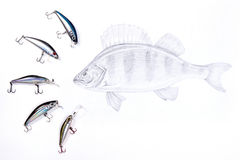 Fishing plastic baits with drawing fish on the white background. Royalty Free Stock Photography