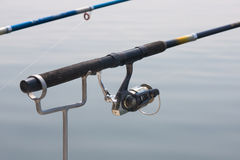Fishing pole. A fishing pole and tackle above the water Stock Photography