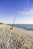 Fishing pole against ocean Royalty Free Stock Photos