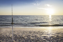 Fishing pole against ocean Stock Images