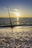 Fishing pole against ocean Stock Photos