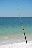 Fishing pole on beach. Fishing pole angled on beach Royalty Free Stock Photo